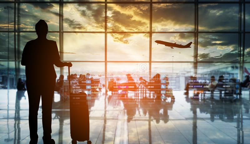 Silhouettes passenger airport terminal. Airline travel concept. Silhouettes passenger airport. Airline travel concept royalty free stock photos