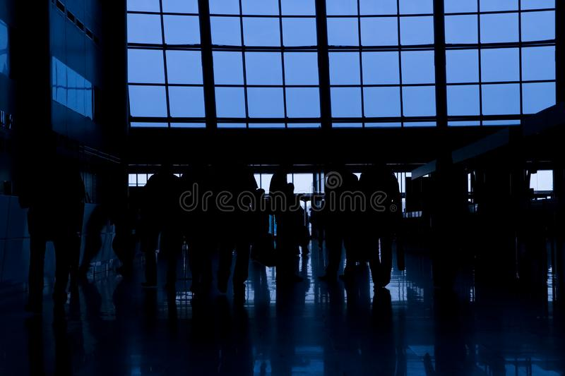 Silhouettes of people in business center royalty free stock photo