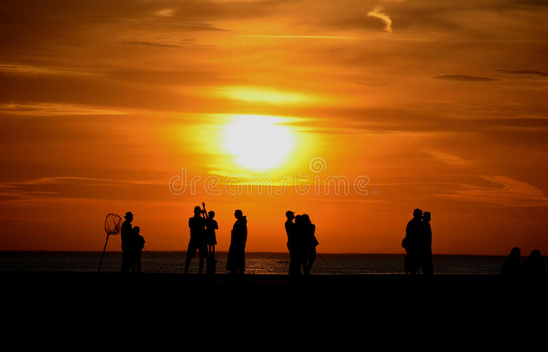 Silhouettes Of People On Pier Stock Photos