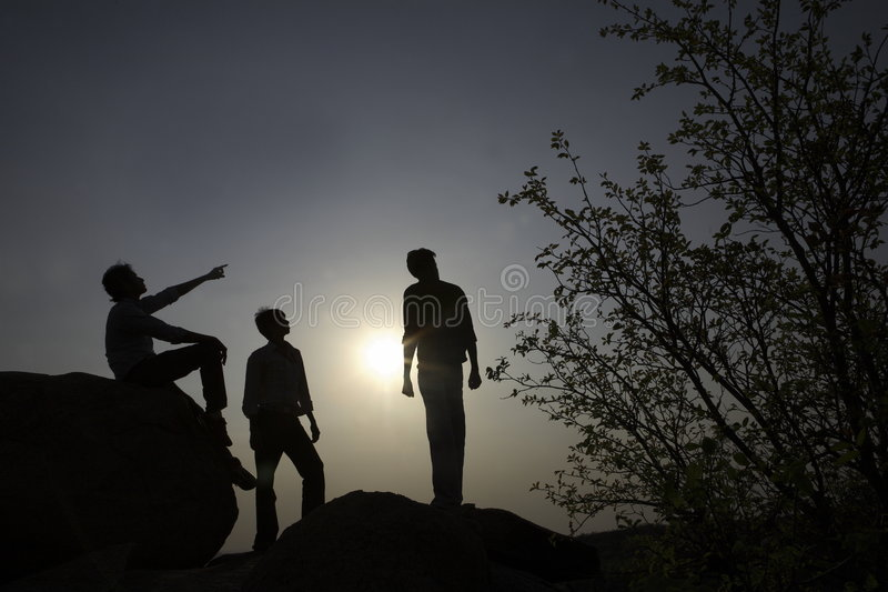 Download Silhouettes Of People On Rocks Stock Photo - Image: 8962520