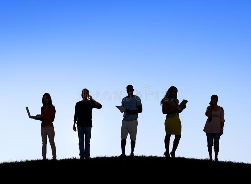 Silhouettes of People Social Networking Outdoors stock images