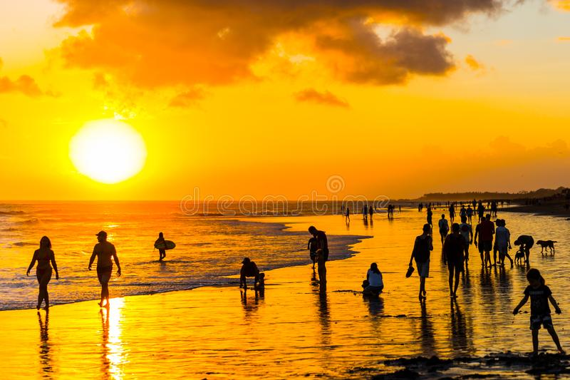 Silhouettes of people on a sunset background on the beach of Bali, Indonesia stock photos