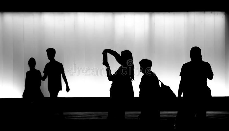 Silhouettes of people walking in the night royalty free stock photography