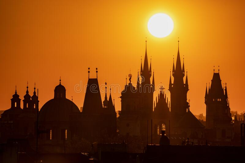 Silhouettes of Prague towers at sunrise. royalty free stock images