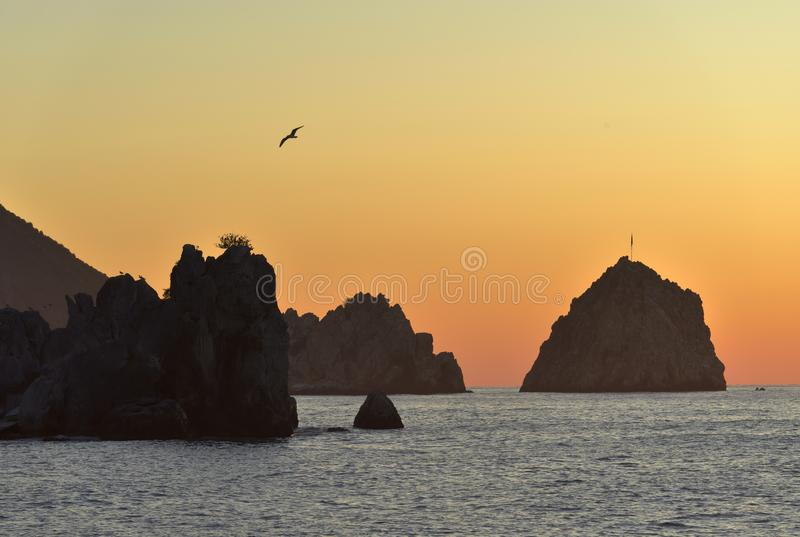 Rocks in the sea at dawn royalty free stock images