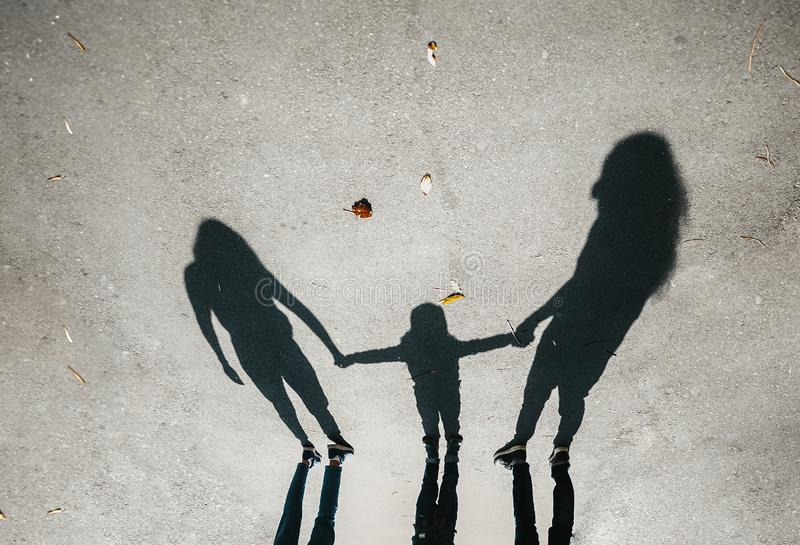 Silhouettes, shadow of a family on the pavement stock photo
