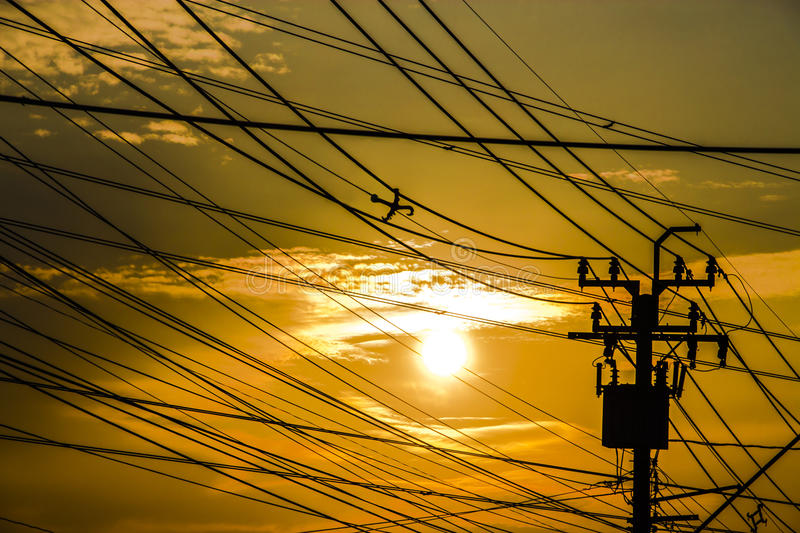 Silhouettes sky contrast with electric toll. Nature and industrial can be beautiful together stock image