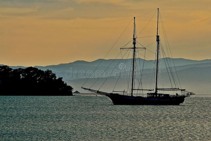 Silhouettes in a small bay. Porto Cheli,Peloponesse,Greece royalty free stock image