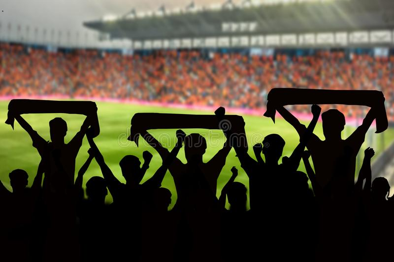 Silhouettes of Soccer fans in a match and Spectators at football stock images