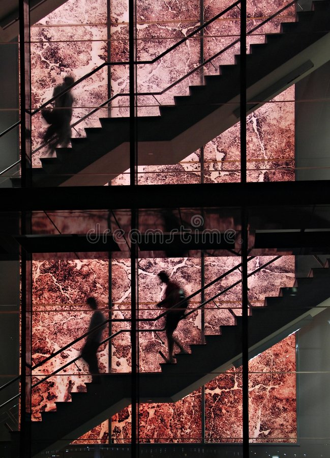 Silhouettes on staircase royalty free stock photography