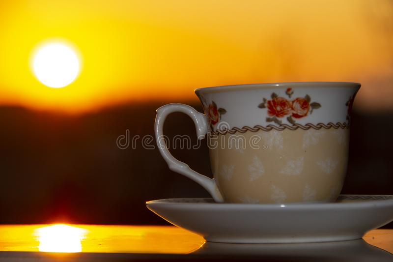 Silhouettes of sunrise morning coffee.  royalty free stock image