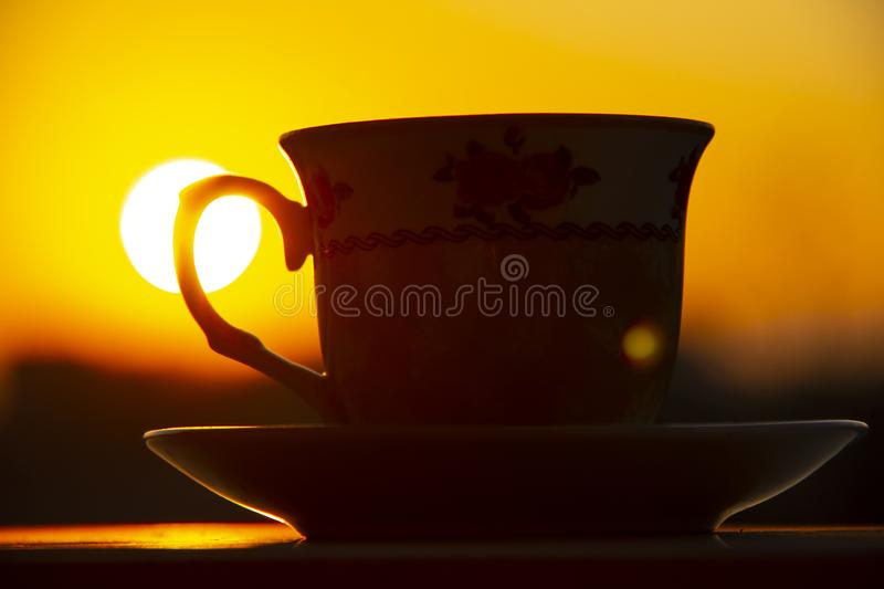 Silhouettes of sunrise morning coffee.  stock photos