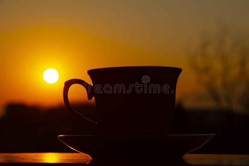 Silhouettes of sunrise morning coffee royalty free stock photo