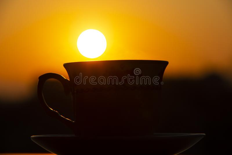 Silhouettes of sunrise morning coffee stock images