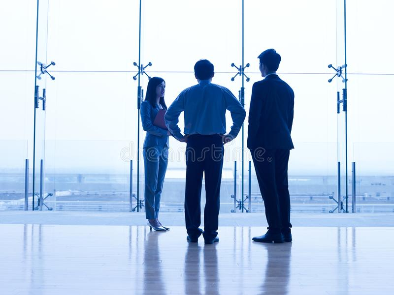 Silhouettes of asian business people royalty free stock photo