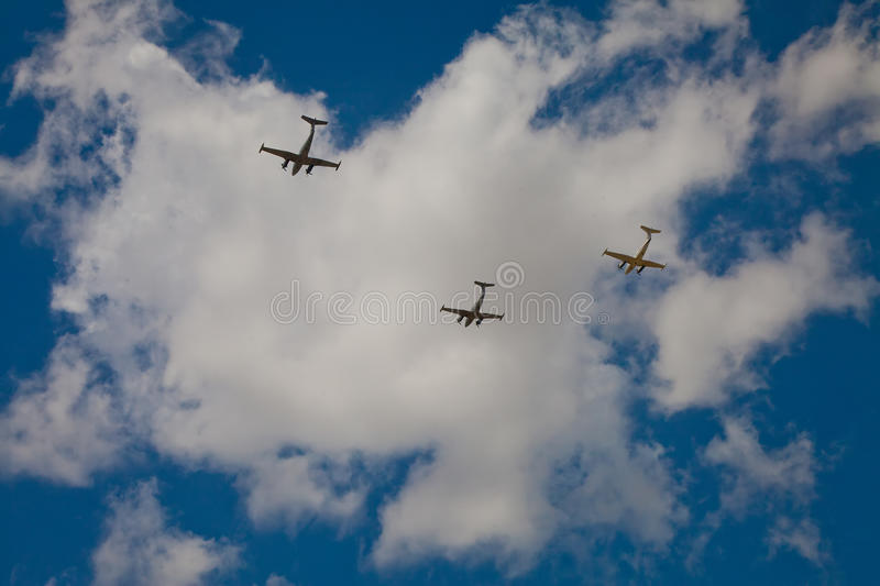 Silhouettes of three Beechcraft airplanes in deep blue sky royalty free stock images