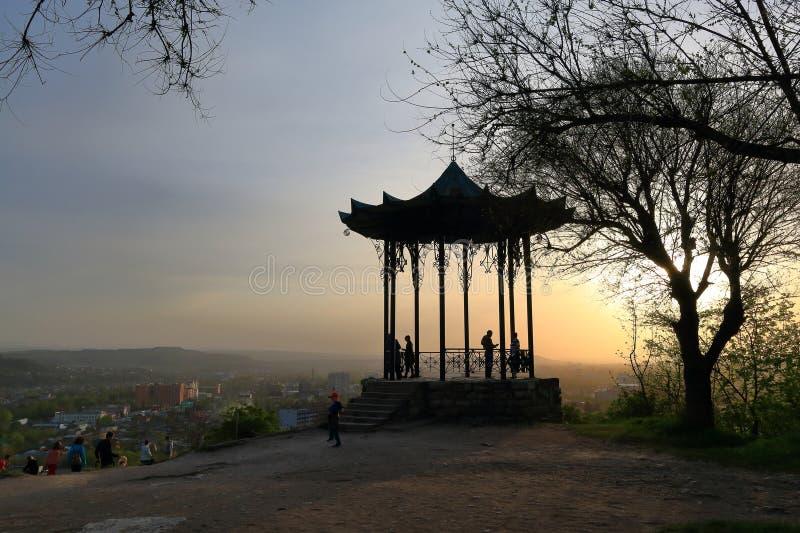 Silhouettes of tourists and a Chinese Gazebo at sunset. Pyatigorsk stock photo