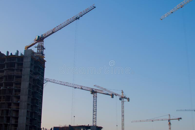 Silhouettes Of Tower Cranes Constructing A New Residential ...
