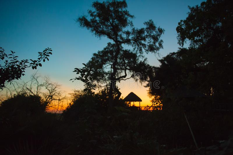 Sunrise behind pavilion of lodge in Botswana, Africa royalty free stock photos