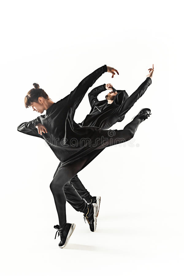 The silhouettes of two hip hop male and female break dancers dancing on white background royalty free stock photo