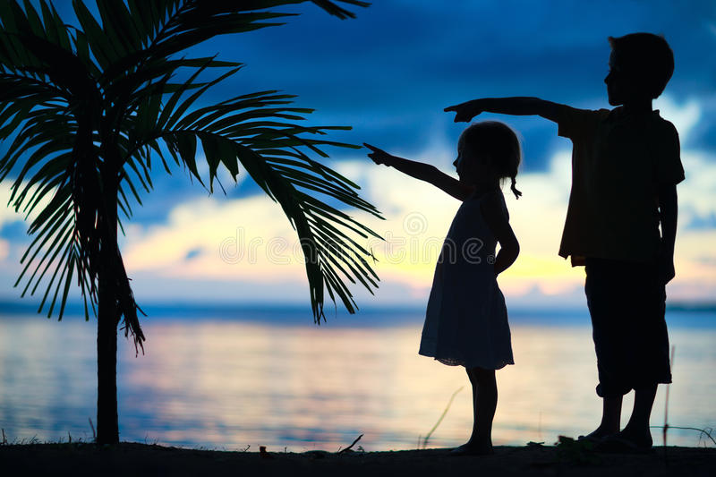 Silhouettes of two kids