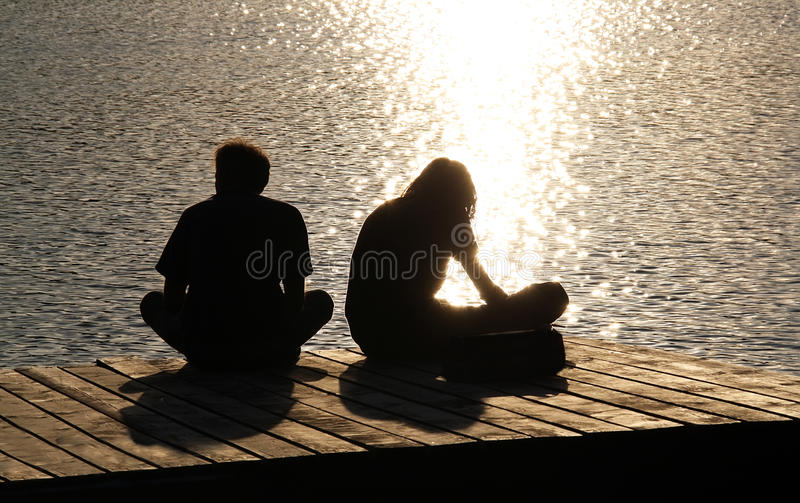 Silhouettes Of Two Young People Royalty Free Stock Photography