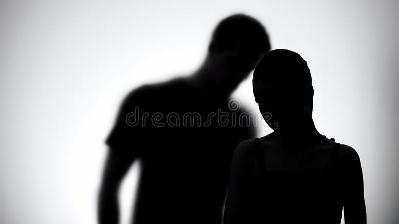 Silhouettes of upset woman and man together, experiencing life difficulties stock photos
