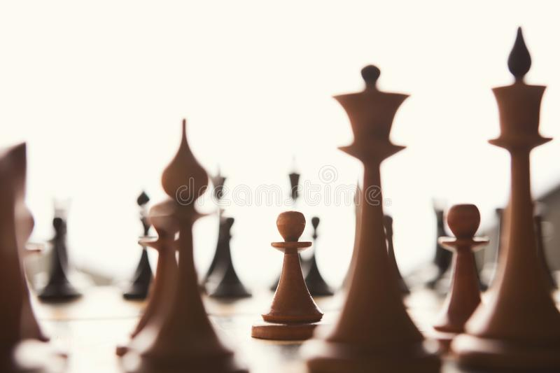 Silhouettes of chess figures on white background stock photo