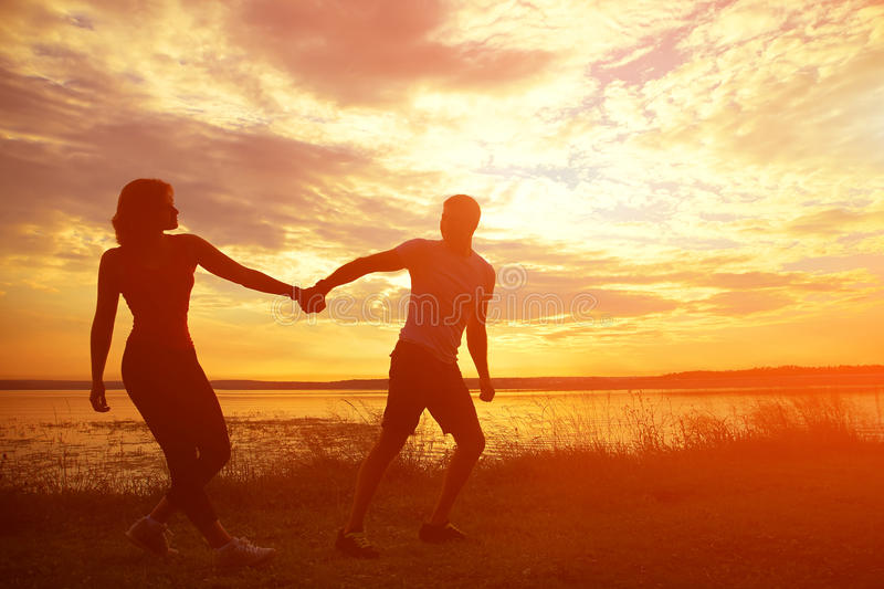 Silhouettes of a young couple royalty free stock photography