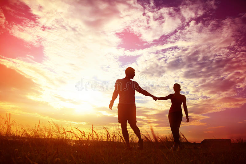 Silhouettes of a young couples royalty free stock image