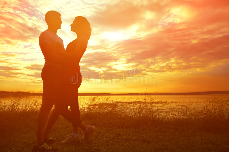 Silhouettes of a young couples stock images