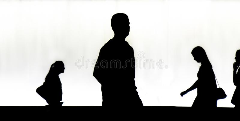 Silhouettes of young  people walkingr in the night stock photos