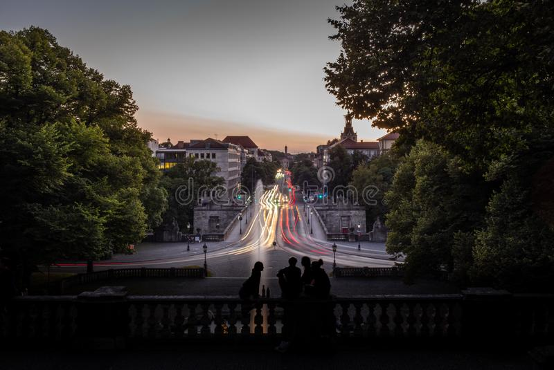 Silhouettes of young people watching the sunset in Munich in Ger stock images