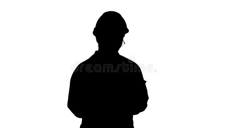 Silhouettez jeune l'ingénieur songeur et réfléchi travaillant avec son comprimé illustration stock