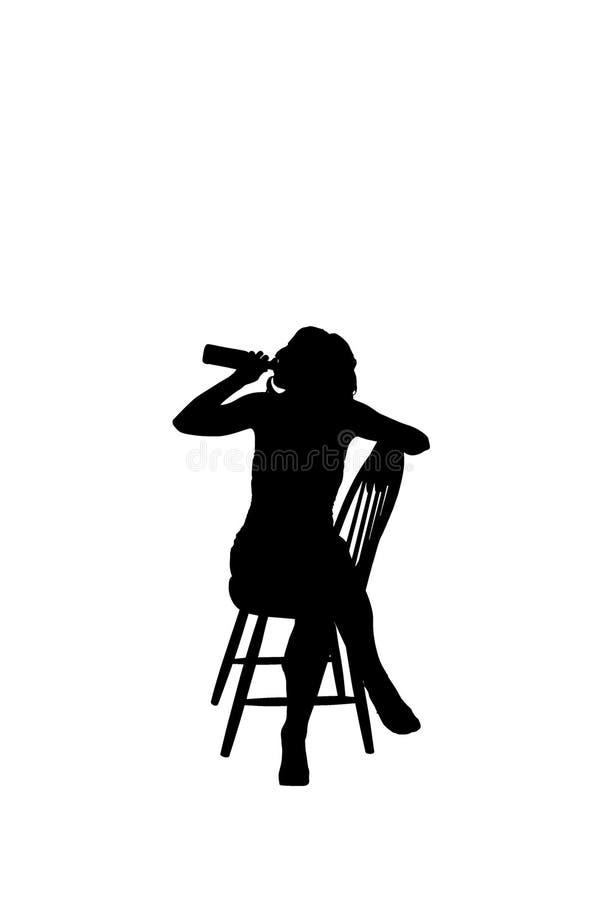 Silhoutte av ett kvinnasammanträde på en stol royaltyfri fotografi