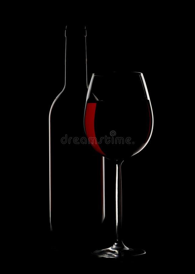 Silhoutte en verre et de bouteille de vin images libres de droits