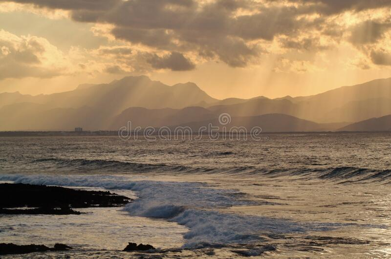 Download Silhoutte Of Mountain Distant From Body Of Water Stock Image - Image of seascape, water: 83010551