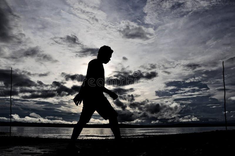 Silhoutte Wondama plaży zmierzch fotografia royalty free
