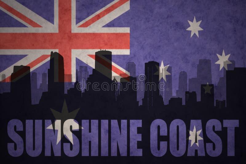 Silhueta abstrata da cidade com a costa da luz do sol do texto na bandeira do australiano do vintage fotos de stock