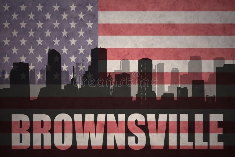 Silhueta abstrata da cidade com texto Brownsville na bandeira americana do vintage foto de stock royalty free