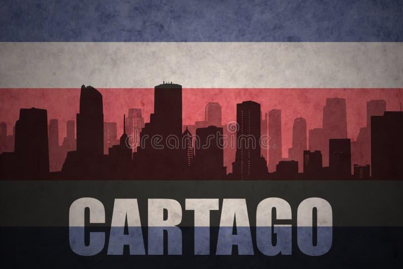 Silhueta abstrata da cidade com texto Cartago na bandeira rican da costela do vintage ilustração royalty free
