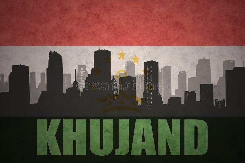 Silhueta abstrata da cidade com texto Khujand na bandeira de tajikistan do vintage fotografia de stock royalty free