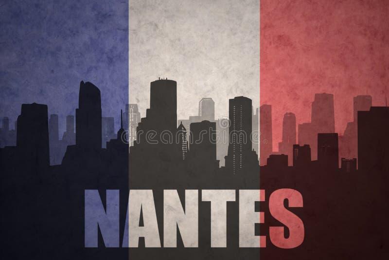Silhueta abstrata da cidade com texto Nantes na bandeira do francês do vintage ilustração royalty free