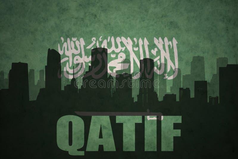 Silhueta abstrata da cidade com texto Qatif na bandeira de Arábia Saudita do vintage fotografia de stock