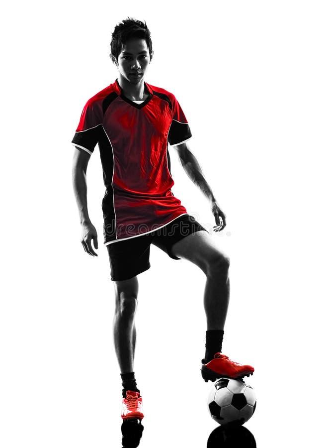 Silhueta asiática do homem novo de jogador de futebol foto de stock