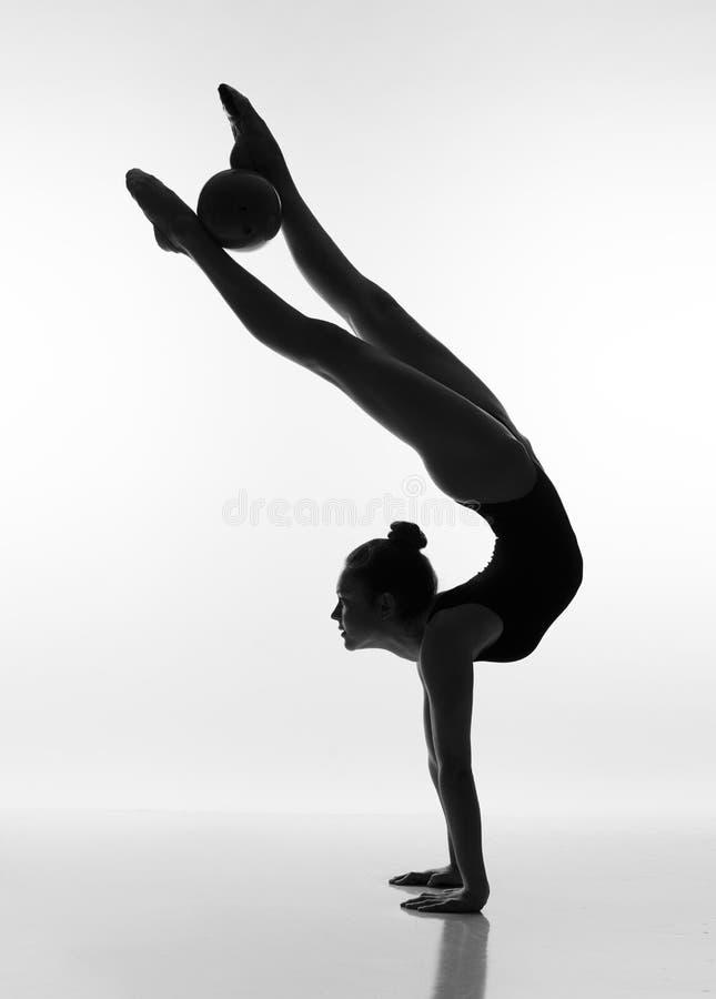 Silhueta da bailarina no fundo branco fotografia de stock