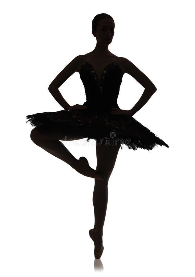 Silhueta da bailarina que faz a pirueta da posição de bailado contra o fundo branco, isolado fotos de stock royalty free