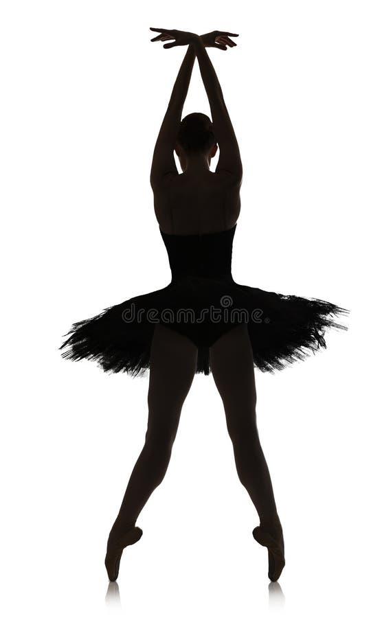 Silhueta da bailarina que faz a posição de bailado contra o fundo branco, isolado fotos de stock
