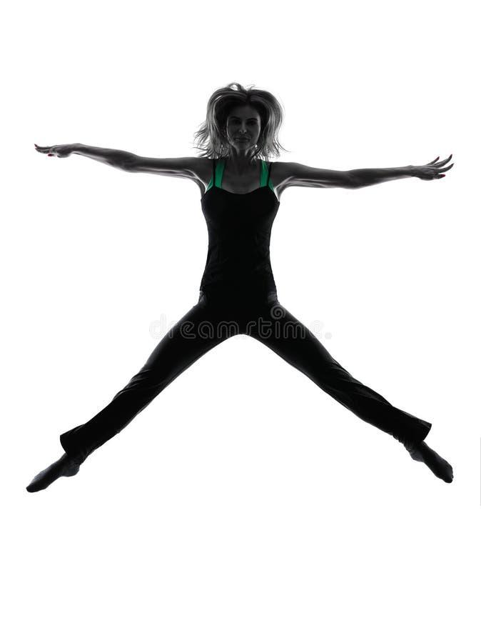 Silhueta da dança do dançarino da mulher fotografia de stock royalty free