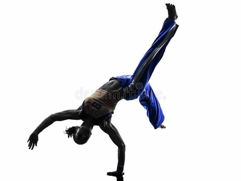 Silhueta da dança do dançarino do capoeira da mulher fotografia de stock royalty free